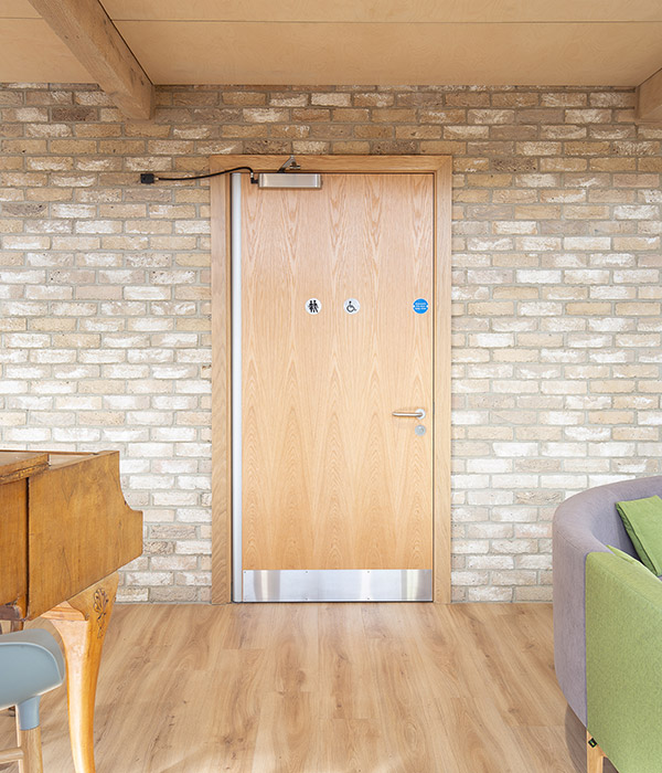 Veneered WC door supplied to Noah's Ark by Doorview Ltd
